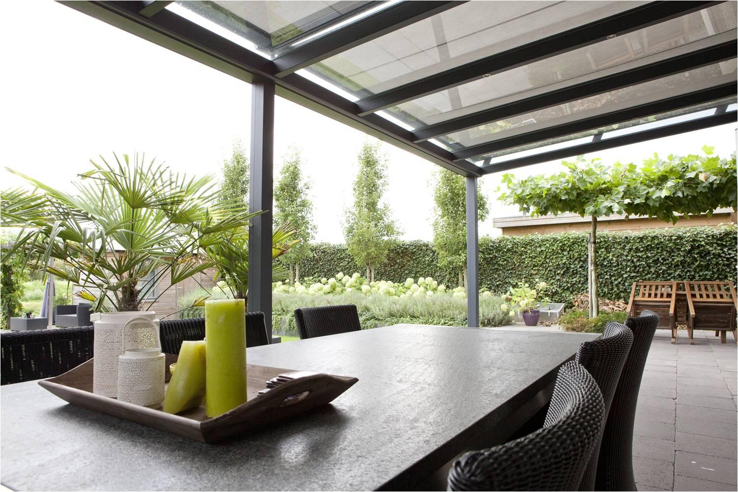 Prachtige terrasoverkapping maak uw tuin klaar voor de zon - Gordijnen voor overdekt terras ...